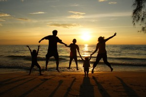 A family enjoys their vacation rental as the sun sets.